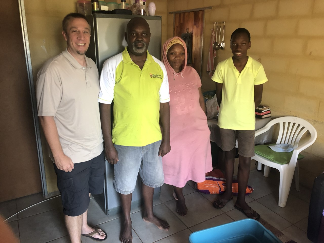 Darin Ishler making a food delivery to a South African family.